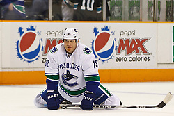 March 10, 2011; San Jose, CA, USA;  Vancouver Canucks left wing Raffi Torres (13) warms up before the game against the San Jose Sharks at HP Pavilion. Vancouver defeated San Jose 5-4 in shootouts. Mandatory Credit: Jason O. Watson / US PRESSWIRE