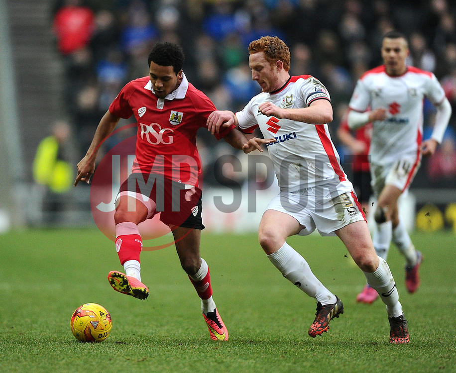 Bristol City's Korey Smith battles for the ball with Milton Keynes Dons' Dean Lewington  - Photo mandatory by-line: Joe Meredith/JMP - Mobile: 07966 386802 - 07/02/2015 - SPORT - Football - Milton Keynes - Stadium MK - MK Dons v Bristol City - Sky Bet League One