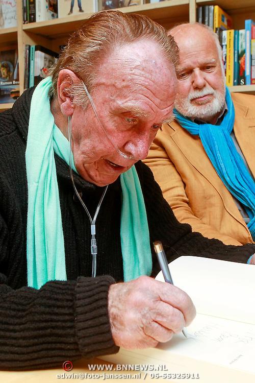 NLD/Rotterdam/20110407 - Acteur Kees Brusse signeert zijn boek, samen met Henk van der Horst