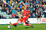 York City's William Boyle tackles Plymouth Argyle's Reuben Reid during the Sky Bet League 2 match between Plymouth Argyle and York City at Home Park, Plymouth, England on 28 March 2016. Photo by Graham Hunt.