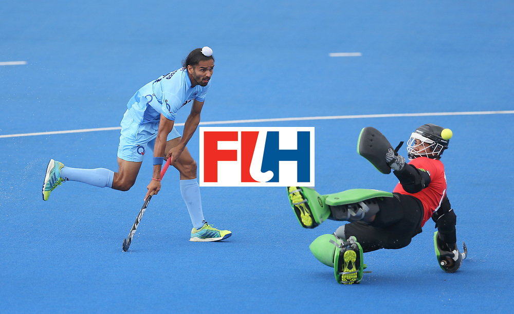 LONDON, ENGLAND - JUNE 24: Akashdeep Singh of India attempts to chip Amjad Ali of Pakistan during the 5th-8th place match between Pakistan and India on day eight of the Hero Hockey World League Semi-Final at Lee Valley Hockey and Tennis Centre on June 24, 2017 in London, England. (Photo by Steve Bardens/Getty Images)