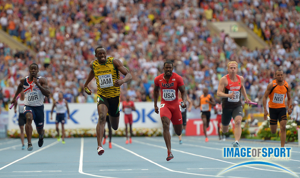 Aug 18, 2013; Moscow, RUSSIA; Usain Bolt (second from left) anchors the Jamaica 4 x 100m relay team to victory in 37.36 in the 14th IAAF World Championships in Athletics at Luzhniki Stadium. From left: Dwain Chambers (GBR), Bolt and Justin Gatlin (USA), Martin Keller (GER) and Hensley Paulina (NED).