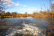 White water caused by a weir on the River Stour at Dedham, Essex, England