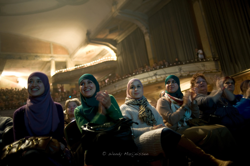 Young muslim women attend the debate at the 'Feest van de sociale politiek' in Antwerp, a week before the local elections in Antwerp. Mayor Patrick Janssens and Bart de Wever cancelled last minute and didn't attend the event. Antwerpen, Belgium, 2012