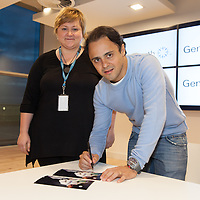 Genworth employee Irene Hulevych getting some photographs signed by Formula One Driver Felipe Massa
