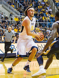 Nov 11, 2016; Morgantown, WV, USA; West Virginia Mountaineers forward Nathan Adrian (11) drives to the basket during the second half against the Mount St. Mary's Mountaineers at WVU Coliseum. Mandatory Credit: Ben Queen-USA TODAY Sports