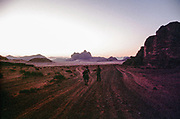 people in desert landscape at dawn or dusk, Middle East Tek, Wadi Rum, Jordan, 2008
