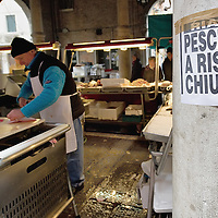 """VENICE, ITALY - FEBRUARY 08:  Signs complaining about the possible closure of the historic Rialto Fish Market on February 8, 2011 in Venice, Italy. The Rialto Fish Market recently associated with the actor Johnny Depp because it appears in some scenes of the movie """"The Tourist"""" risks closure if plans to move the fish wholesale market from Venice to Fusina go ahead."""