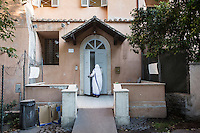 ROME, ITALY - 27 AUGUST 2016: A sister opens the door of the accommodation center ran by the Sisters of the Missionaries of Charity, the religious congregation founded by Mother Teresa in 1950, at San Gregorio al Celio in Rome, Italy, on August 27th 2016.<br /> <br /> Mother Teresa, also known as Blessed Teresa of Calcutta, was an Albanian Roman Catholic nun and missionary. She founded the Missionaries of Charity, a Roman Catholic religious congregation, whose members must adhere to the vows of chastity, poverty, and obedience, as well as the vow to give wholehearted free service to the poorest of the poor. Shortly after she died in 1997, Pope John Paul II waived the usual five-year waiting period and allowed the opening of the process to declare her sainthood. She was beatified in 2003. A second miracle was credited to her intercession by Pope Francis, in December 2015, paving the way for her to be recognised as a saint by the Roman Catholic Church. Her canonisation is scheduled for September 4th 2016, a day before the 19th anniversary of her death.