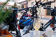 Cycling tour concept. At rest at an open air cafe the bicycles are close by. With an out of focus urban background. Photographed in Coimbra, Portugal