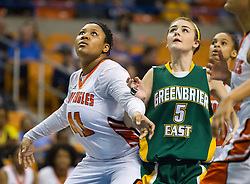 South Charleston center Aryaunne Mosley (41) boxes out Greenbrier East forward Katelyn Wilmer (5) during a first round game at the Charleston Civic Center.