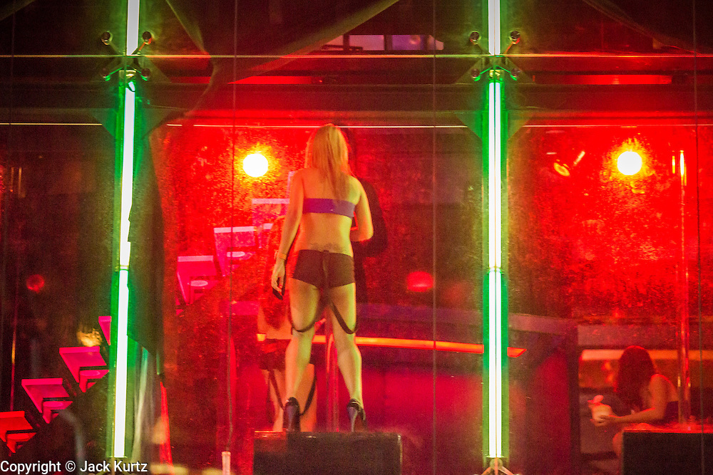 4 JUNE 2013 - BANGKOK, THAILAND:  Dancers in the Black Pagoda, an adult oriented business in the Patpong Night Bazaar in Bangkok. Patpong was one of Bangkok's notorious red light districts but has been made over as a night market selling clothes, watches and Thai handicrafts. The old sex oriented businesses still exist but the area is now better known for its night shopping.      PHOTO BY JACK KURTZ