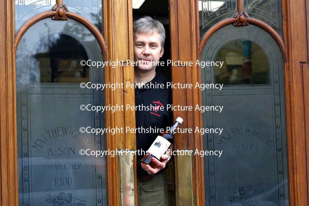 Derek Brown of Famous Grouse Whisky who are appealing for old 'Grouse related items' for the new 'Famous Grouse experience being constructed at Glenturret Distillery.<br />Derek is pictured with original stained glass doors from the Matthew Gloag Distillery and an old bottle of Famous Grouse Whisky<br />See press release by Jackie Martin on 01738 493640<br /><br />Picture by Graeme Hart.<br />Copyright Perthshire Picture Agency<br />Tel: 01738 623350  Mobile: 07990 594431