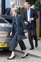 © Licensed to London News Pictures . 02/10/2017. Manchester, UK. Chancellor PHILIP HAMMOND and Prime Minster THERESA MAY leave for a visit in Manchester on the morning of the second day of the Conservative Party Conference at the Manchester Central Convention Centre . Photo credit: Joel Goodman/LNP