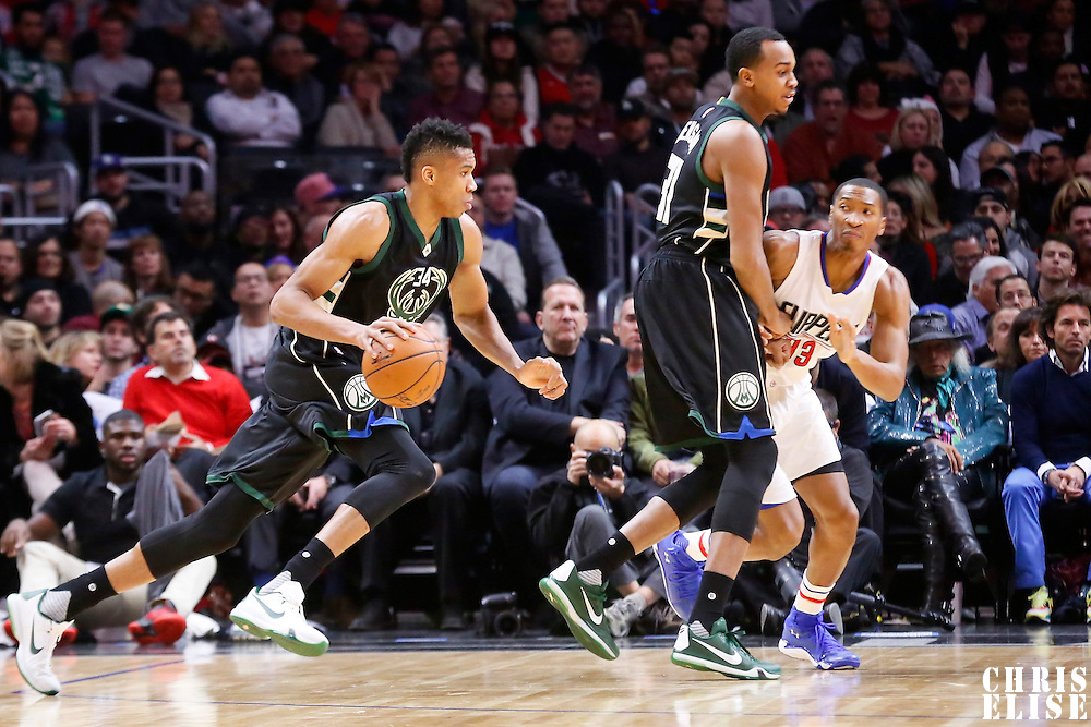 16 December 2015: Milwaukee Bucks forward Giannis Antetokounmpo (34) drives past Los Angeles Clippers forward Wesley Johnson (33) on a screen set by Milwaukee Bucks forward John Henson (31) during the Los Angeles Clippers 103-90 victory over the Milwaukee Bucks, at the Staples Center, Los Angeles, California, USA.