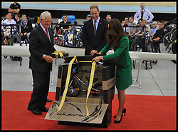 The Duke and Duchess of Cambridge are presented a cycle for Prince George  as they open the new Cycling Centre of Excellence Velodrome in Hamilton, New Zealand, on day 6 of the  Royal Tour of New Zealand and Australia, Saturday, 12th April 2014. Picture by Andrew Parsons / i-Images