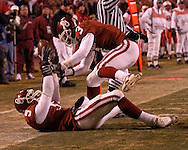 University of Oklahoma defensive back Nic Harris celebrates with teammate Reggie Smith (3) after intercepting a Nebraska pass in the fourth quarter during the Big 12 Championship game at Arrowhead Stadium in Kansas City, Missouri, December 2, 2006.  The Sooners beat Nebraska 21-7.<br />