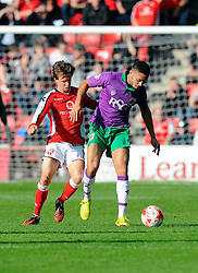 Bristol City's Derrick Williams battles for the ball with Walsall's James Baxendale  - Photo mandatory by-line: Joe Meredith/JMP - Mobile: 07966 386802 - 04/10/2014 - SPORT - Football - Walsall - Bescot Stadium - Walsall v Bristol City - Sky Bet League One