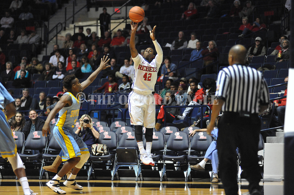 "Ole Miss' guard Stefan Moody (42) makes a three pointer vs. Southern at the C.M. ""Tad"" Smith Coliseum in Oxford, Miss. on Thursday, November 20, 2014. (AP Photo/Oxford Eagle, Bruce Newman)"