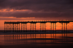 © Licensed to London News Pictures. <br /> 05/04/2017<br /> Saltburn-by-the-Sea, UK. <br />  <br /> The sun rises over the Victorian pier at Saltburn-by-the-Sea in North Yorkshire.<br /> <br /> Photo credit: Ian Forsyth/LNP