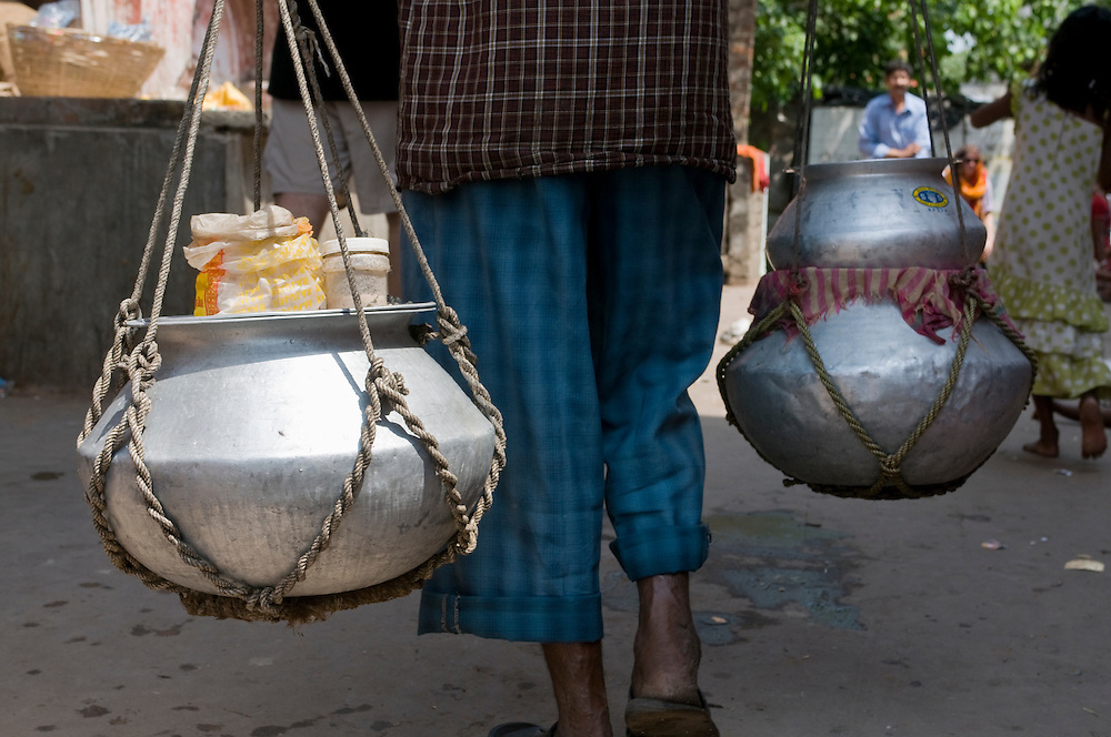 Man carrying his shopping in typical bags. Calcutta. India.