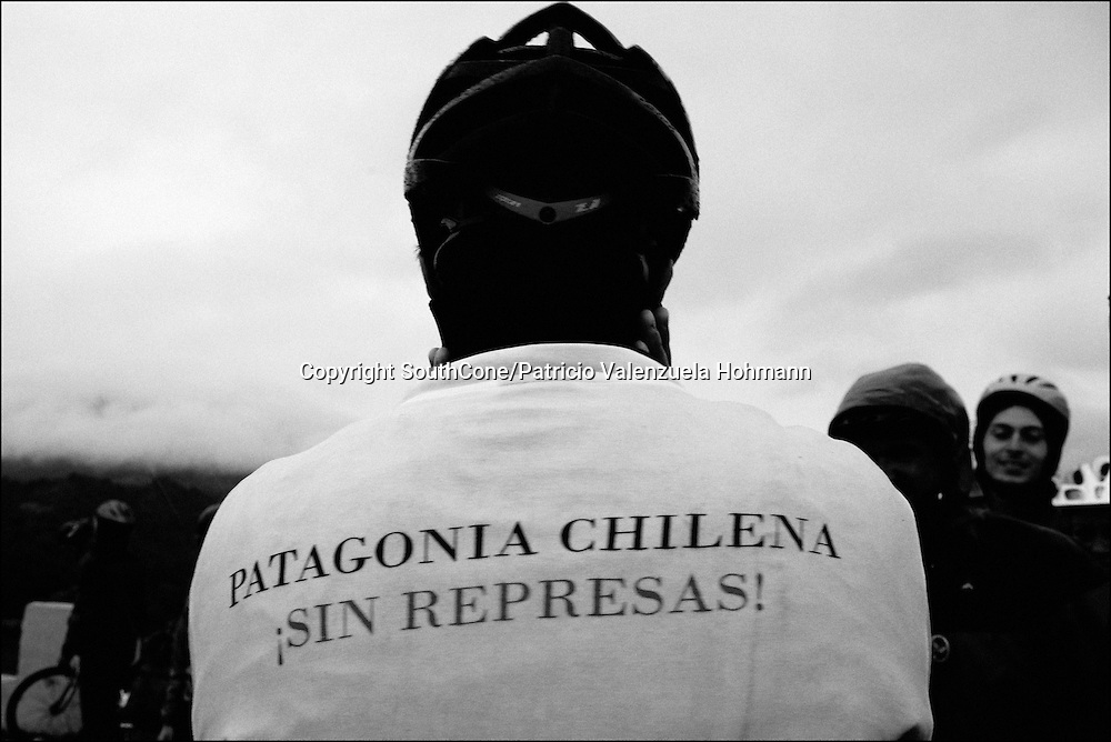 An activist wears a t-shirt that reads &quot;Chilean Patagonia without dams&quot;, a strong citizen movement has rise up to oppose the Hidroaysen Project, nevertheless authorities try to misinform about the project. <br /> In Chile`s western Patagonia the Balseros (boatmen) of the Baker river are in danger of loosing it`s ways of work as the last  families that live on logging (only dead trees logging permitted by law) move their production using the river as a highway and natural landscape are threaten by the &quot;Hydroaysen Project&quot;, a $3 billion project which plans to build five dams in Patagonia rivers, two of  them in the Baker river, flooding thousands of hectares and building a 3.000 km. long transmission line which will send energy to the huge northern Chilean mining industry destroying one of the world most pristine and untouched natural areas of the planet. As South America holds one of the worlds biggest water resources of the planet first world companies such as the Italian ENEL, the Spanish Endesa, among others want to put their hands on them. By corporate lobbing they promote state corruption, divide communities and lie to citizens as new clean energy generating ways are taking the lead around the globe they promote old, destructive and obsolete energy generating ways.