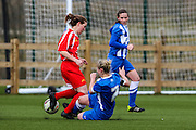 Cardiff's Hope Suominen is tackled by Jay Blackie during the FA Women's Premier League match between Brighton Ladies and Cardiff City Ladies at Brighton's Training Ground, Lancing, United Kingdom on 22 March 2015. Photo by Geoff Penn.