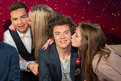© licensed to London News Pictures. London, UK 26/03/2013. One Direction fans kissing new wax figures of the band members at Madame Tussauds London on Thursday 18 April 2013. Photo credit: Tolga Akmen/LNP