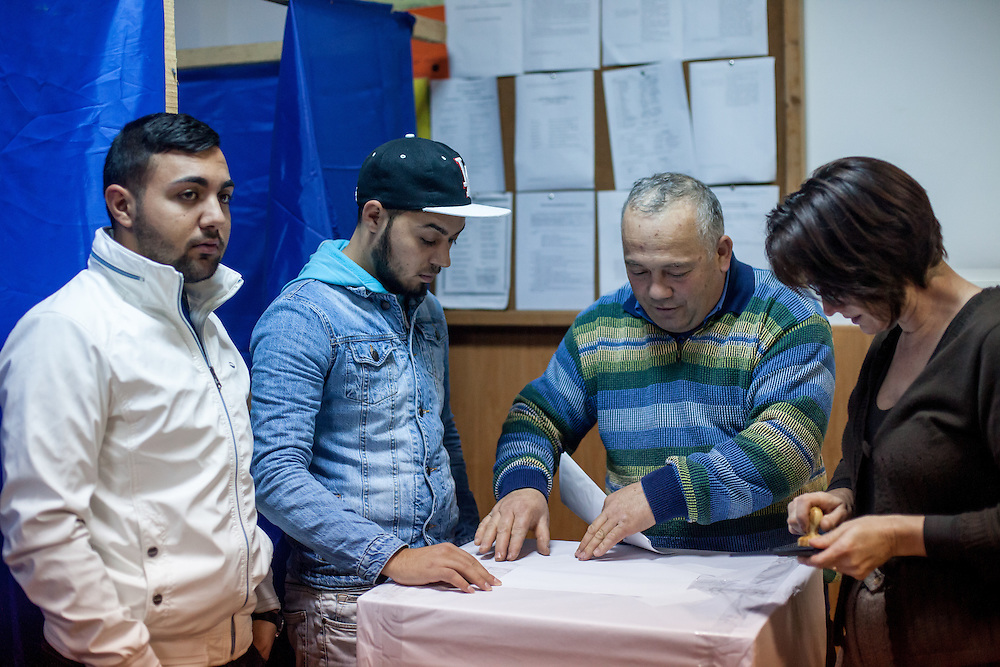 Volunteers - Roma and non Roma - preparing the ballot box on the evening before the upcoming presidential elections in the local school which will be a polling station the next day.