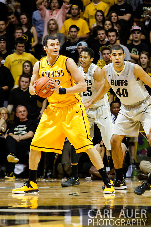 November 13th, 2013:  University of Wyoming Cowboys junior forward Larry Nance Jr. (22) looks to pass the ball in the second half of the NCAA Basketball game between the University of Wyoming Cowboys and the University of Colorado Buffaloes at the Coors Events Center in Boulder, Colorado