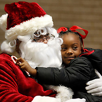 Thomas Wells | BUY at PHOTOS.DJOURNAL.COM<br /> Sa'Miah Gilleylen gives Santa a big hug as she and others from Haven Acres Head Start and Shannon Primary School spend some quality time with Santa at Renasant Bank Monday morning.
