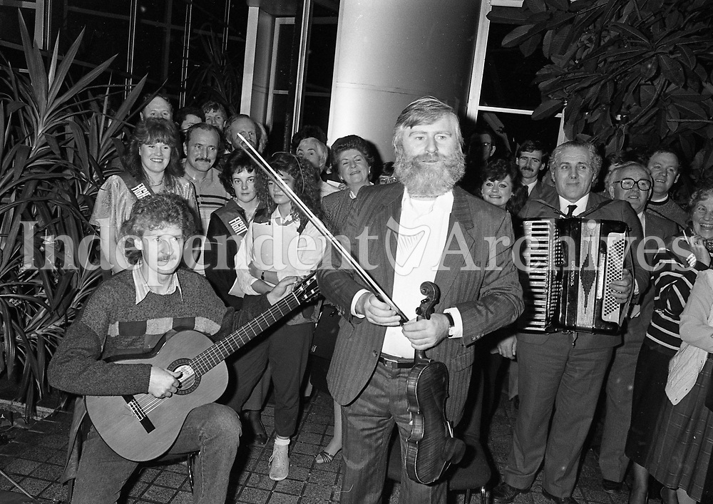 "John Sheahan, Composer and member of The Dubliners Playing ""The Marino Waltz"" a song which he composed, in the Bord na Mona offices in Baggot Street, Dublin, 17/12/1987 (Part of the Independent Newspapers Ireland/NLI Collection)."