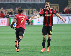 July 15, 2018 - Atlanta, GA, USA - Atlanta United midfielder Josef Martinez gets five from Julian Gressel after scoring a goal against the Seattle Sounders to tie the game 1-1 during the second half on Sunday, July 15, 2018, in Atlanta, Ga. (Credit Image: © Curtis Compton/TNS via ZUMA Wire)