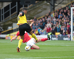 Watford's Troy Deeney has a shot blocked  - Photo mandatory by-line: Nigel Pitts-Drake/JMP - Tel: Mobile: 07966 386802 14/09/2013 - SPORT - FOOTBALL -  Vicarage Road - Hertfordshire - Watford V Charlton Athletic - Sky Bet Championship