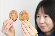 "Jan. 21, 2009; Obama, Fukui Prefecture, Japan - Chika Shimada, a clerk at the Wakasaya store, holds up a japanese confectionery with President Obama's face and ""I Love Obama"" slogan stamped on it."