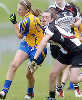 Clare's Captain Chloe Moloney scores again for the banner county despite efforts from Sligo's  Caitriona Cawley in the All ireland U14 C championship final in Kilkerrin-Galway Photo: Andrew Downes..