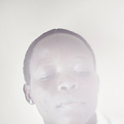 OCHIENG<br /> I was born a lady but I wish I could be reborn as a man. <br /> <br /> Transgenders are not accepted in any place. People do not respect individuality here in Kenya. Many People do not know my identity. They call me a lesbian or bisexual, but I am none of those things.<br /> <br /> I was raped in the village one day when I was going to fetch water. They wanted to punish me. I knew that before they did. The person who raped me died last year. I got pregnant and wanted to get an abortion, but did not have the money to do it. I have a baby girl but she stays at my moms place.<br /> <br /> My dream for the future is that we get a free society where our voices are heard and respected and there is zero percent discrimination. For me personally my dream is that I can get the money to be transformed physically into the man I feel I am, so my body reflects my soul.