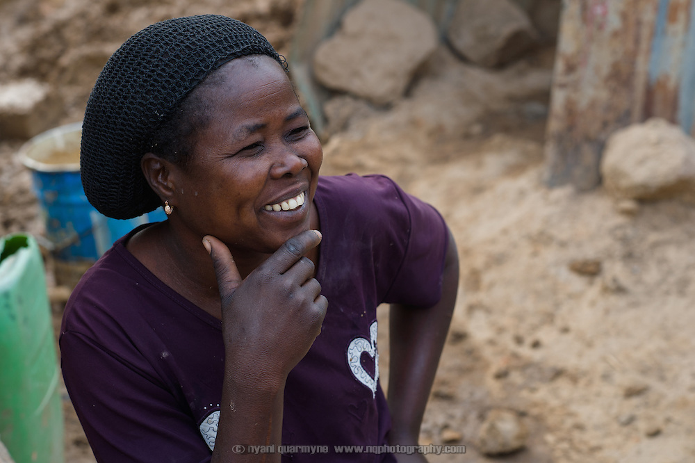 Fati Koanda (40), seen on 24 February 2016, is making mud bricks by hand to build a more permanent structure to replace a makeshift zinc sheet wash room at her home in Zongo, an informal settlement in Burkina Faso's capital, Ouagadougou. She has a separate latrine, which was built under a WaterAid supported program. She is a widow, and lives with her 17 year-old daughter, Safiatou Kafando.