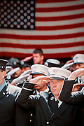 Firemen pay their last respects at the funeral service for Father Mychal F. Judge, New York Fire Brigade Chaplain at Saint Francis of Assisi church in New York. The chaplain died in the collapse of the World Trade Center towers after Tuesday's terrorist attack. In the weeks and months that followed, first responders alternated between search and recovery at the WTC site and attending funerals of fallen colleagues. 411 First responders died on September 11th. Unfortunately, many more were to die in the following years from illnesses possibly caused by the toxic fumes at the WTC site.