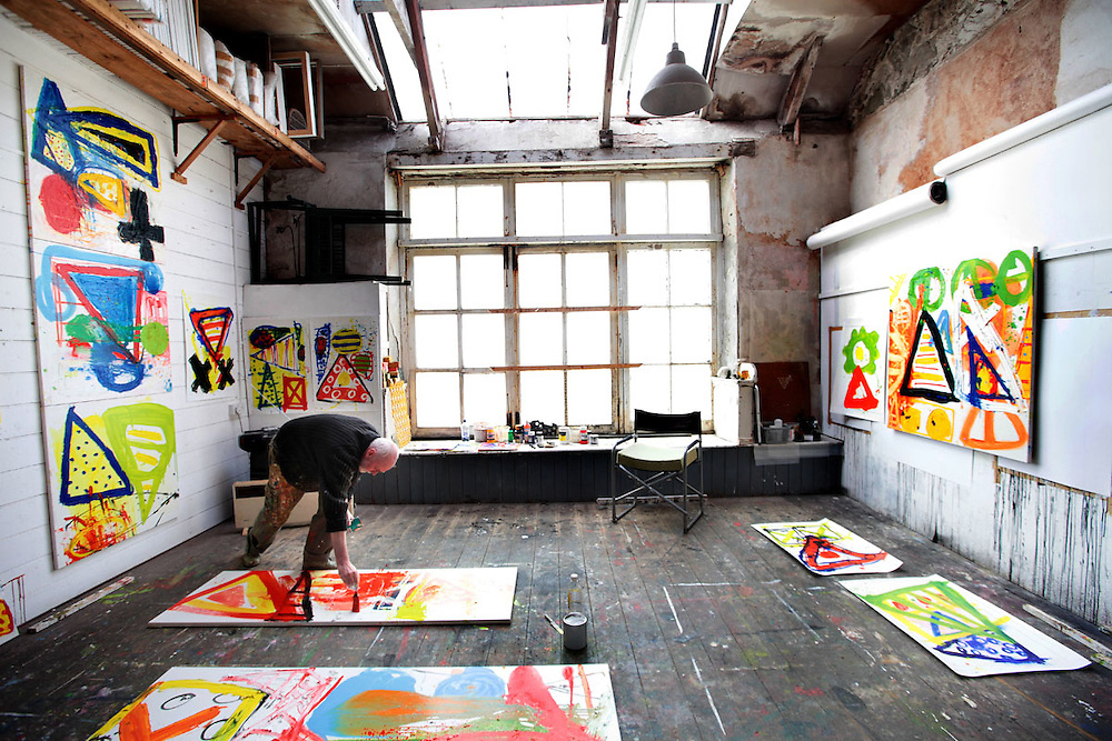 Iain Robertson painting in Studio 7.<br /> Originally built to house the wares of pilchard fishermen, artists moved in to the building in the 1890's. For over 100 years the building has remained virtually untouched. The artists still coexist with the fishermen, painting in the lofts above while the fishermen mend their nets and store their fishing gear in the cellars below. <br /> Now undergoing much needed renovation, Porthmeor Artist's Studios is a microcosm of St Ives two main industries past and present.