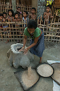 Mising pounding rice<br /> Mising Tribe (Mishing or Miri Tribe)<br /> Majuli Island, Brahmaputra River<br /> Largest river island in India<br /> Assam,  ne India