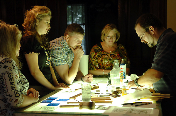 From left, Beverly Arnold, Jolie and Damien Grout and Joey Halinski watch as Mark Bleakley demonstrates the process of making stained glass during a four-day workshop at the Southern Cultural Heritage Center Tuesday afternoon. The workshop, which was limited to five people, covers all the basics of making stained glass. (Bryant Hawkins/The Vicksburg Post)