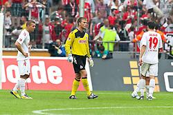06.08.2011,  Rhein Energie Stadion, Koeln, GER, 1.FBL, 1. FC Koeln vs Vfl Wolfsburg, im Bild.Köln entaeuscht / entäuscht / traurig von links:  Lukas Podolski (Koeln #10), Michael Rensing (Torwart Koeln) und Mato Jajalo (Koeln #19)..// during the 1.FBL, 1. FC Koeln vs Vfl Wolfsburg on 2011/08/06, Rhein-Energie Stadion, Köln, Germany. EXPA Pictures © 2011, PhotoCredit: EXPA/ nph/  Mueller *** Local Caption ***       ****** out of GER / CRO  / BEL ******