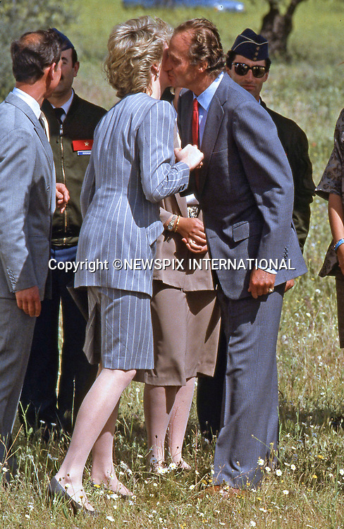 """PRINCE CHARLES AND PRINCESS DIANA SPANISH TOUR 1987.visit Salamanca during their Royal Tour of Spain_April 1987..Picture Shows: King Juan Carlos greeting Princess Diana with a kiss on the hand and cheeks..Mandatory Credit Photo: ©Francis Dias/NEWSPIX INTERNATIONAL..**ALL FEES PAYABLE TO: """"NEWSPIX INTERNATIONAL""""**..IMMEDIATE CONFIRMATION OF USAGE REQUIRED:.Newspix International, 31 Chinnery Hill, Bishop's Stortford, ENGLAND CM23 3PS.Tel:+441279 324672  ; Fax: +441279656877.Mobile:  07775681153.e-mail: info@newspixinternational.co.uk"""