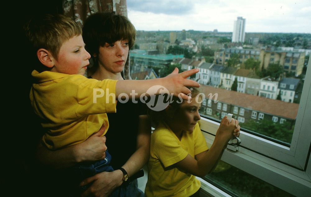 Woman & her children living in high rise council flat; UK