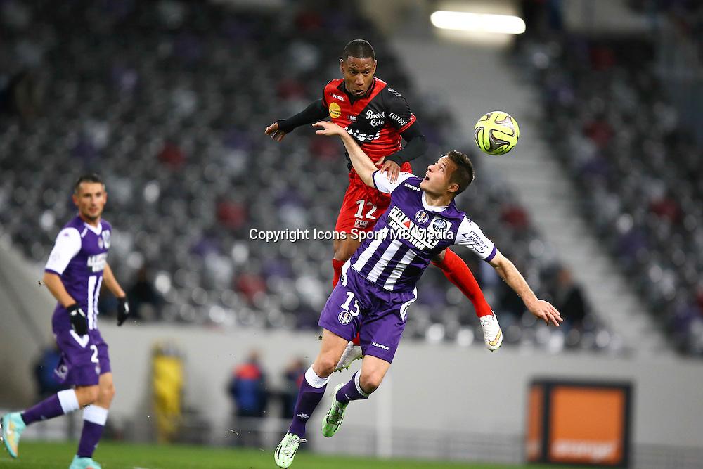 Claudio Beauvue / Uros Spajic - 20.12.2014 - Toulouse / Guingamp - 17eme journee de Ligue 1 <br />Photo : Manuel Blondeau / Icon Sport
