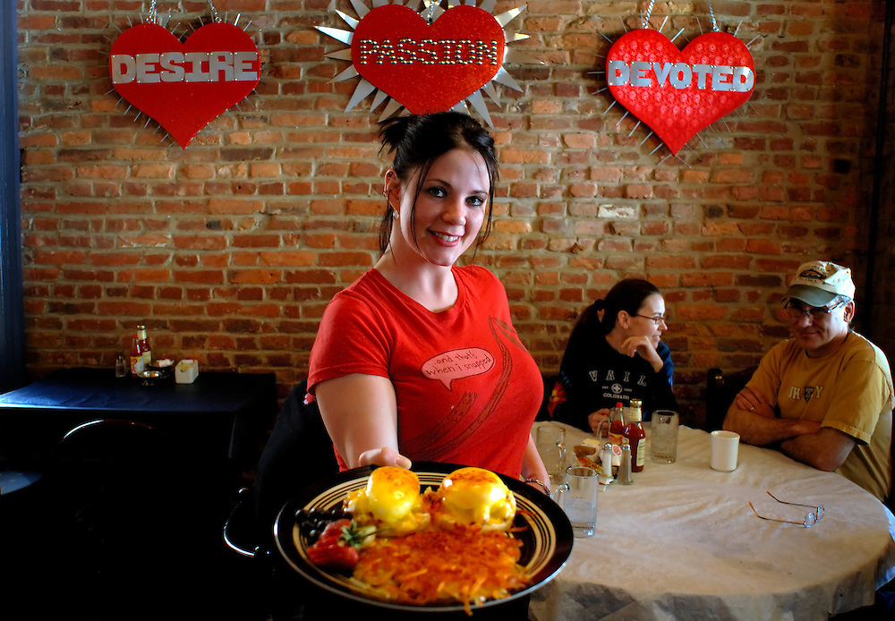 Sarah Simington, owner of the fabulous Blue Moon Cafe poses with her signature lump crabmeat eggs benenedict in the brick-walled dining room of her restaurant in Fell's Point, a historic area in Baltimore...Photo by Susana Raab