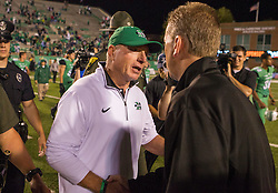 Oct 9, 2015; Huntington, WV, USA; Marshall Thundering Herd head coach Doc Holliday speaks with Southern Miss Golden Eagles head coach Todd Monken at the end of the game at Joan C. Edwards Stadium. Marshall won the game 31-10. Mandatory Credit: Ben Queen-USA TODAY Sports