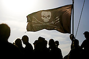 Sea Shepherd crew assemble under a Jolly Roger on the bow of their ship, the M/Y Steve Irwin, on Tuesday, Dec. 2, 2008 in Brisbane, Australia.  Two days later the self-styled, modern-day, 'eco-pirates' (a radical spin-off of the environmental group Greenpeace) departed on a months-long campaign to stop what they deem are illegal Japanese whaling operations in Antarctica's Southern Ocean. (Photo by Adam Lau)