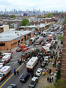 The scene at 60th Street and Broadway where New York City Fire Department evacuated passengers from an emergency escape hatch after a Brooklyn bound F train derailment on Friday, May 2, 2014 in Woodside, N.Y. Photo by Kathy Kmonicek